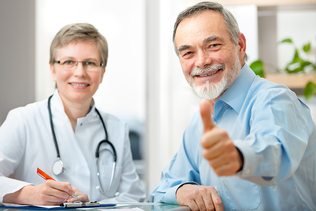 bigstock-Happy-senior-patient-and-docto-74595343