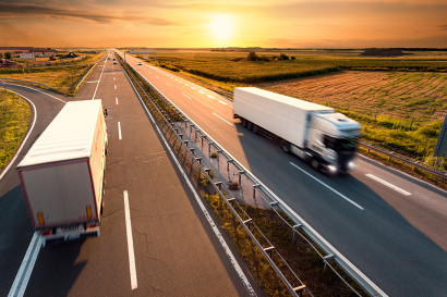 bigstock-Two-Trucks-On-Highway-In-Motio-70870492